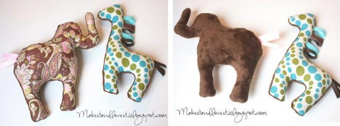 stuffed elephant and stuffed giraffe