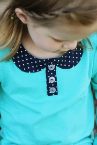 An Attached Peter Pan Collar.....with buttons