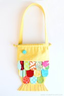 DIY Fabric Fishy Purse...with drawstring closure (pattern pieces included) | via Make It and Love It
