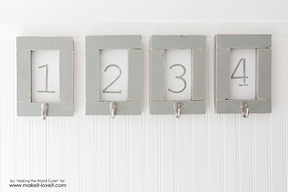 DIY Framed and Numbered Towel Hangers | via www.makeit-loveit.com