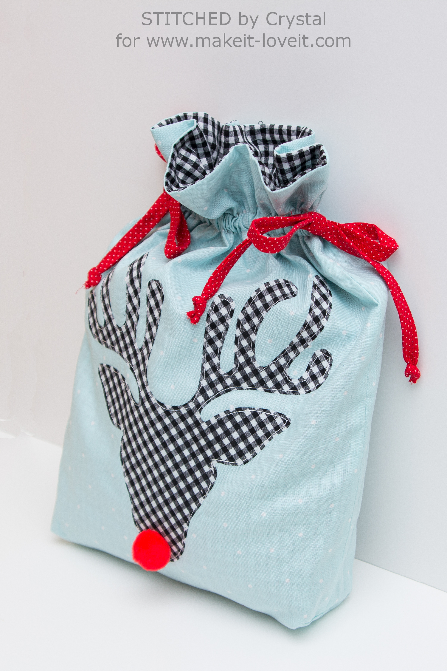 Sew a Reusable Rudolph Gift Bag! | via www.makeit-loveit.com